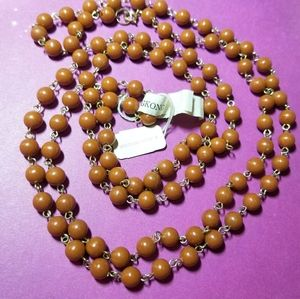 Vintage long brown bead necklace with store tag